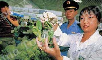 Food safety workers taking test samples at a food market in Beijing's Haidian District.
