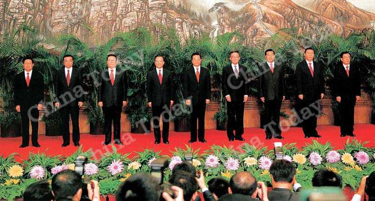 General Secretary Hu Jintao (center) and members of the Standing Committee of the Political Bureau Wu Bangguo, Wen Jiabao, Jia Qinglin, Li Changchun, Xi Jinping, Li Keqiang, He Guoqiang and Zhou Yongkang at the 17th CPC National Congress press conference.