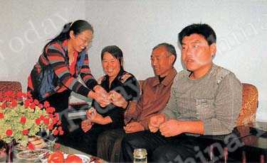 Liu Minghua with his parents and wife, Xiao Haixia, in their new home.